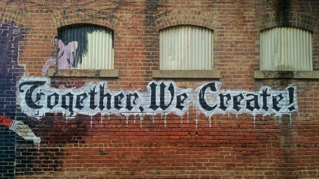 white and black Together We Create graffiti wall decor